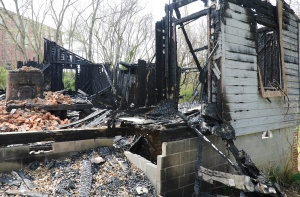 wood framed home completely destroyed by fire